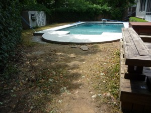 Backyard before our hardscape and landscaping design and installation services